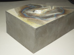 Same piece with the nearest edges cut with our Waterjet system. Notice the difference.